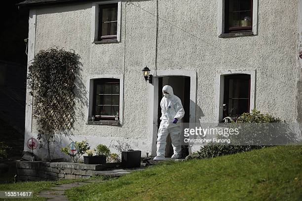 Police forensic scientists search the house of Mark Bridger in the village of Ceinws as the hunt for missing April Jones continues on October 6 2012...