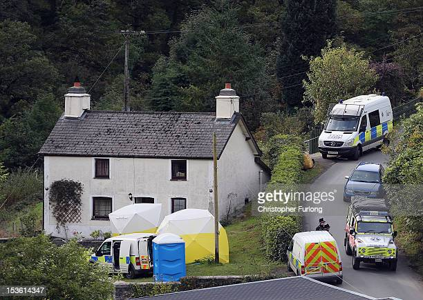 Police forensic scientists work at the house of Mark Bridger in the village of Ceinws as the search for missing April Jones continues on October 7...