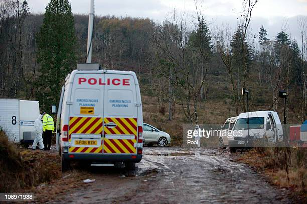 Police forensic teams investigate the scene of an explosion at Garadhban Forrest on November 19 2010 in Gartocharn Scotland Strathclyde Police and...