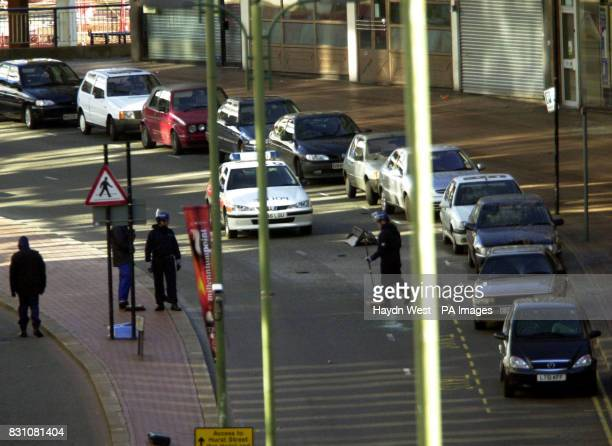 Police forensic teams start a finger search around the boot lid of a car in the road at Smallbrook Queensway in Birmingham City Centre which was...
