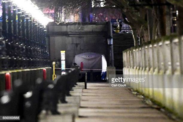 A police forensic tent is erected on a walkway beside Westminster Bridge following a terrorist attack in which a number of pedestrians were mowed...