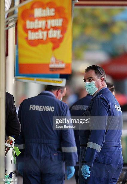 Police Forensics examine the crime scene where underworld figure Desmond 'Tuppence' Moran was shot dead earlier today at Ascot Vale on June 15 2009...