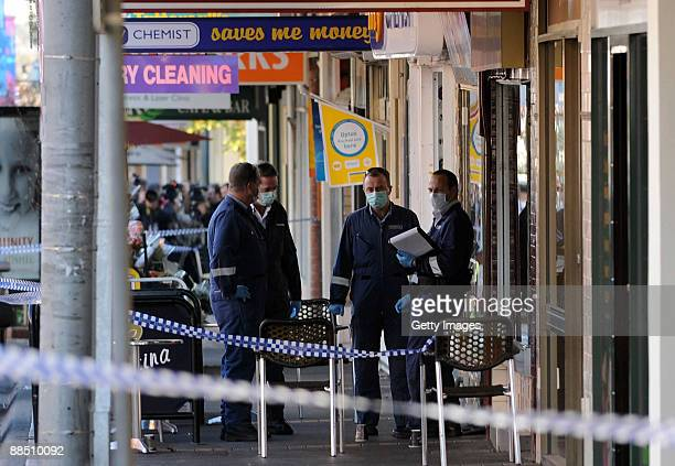 Police forensics examine the crime scene where underworld figure Desmond 'Tuppence' Moran was shot dead earlier today, at Ascot Vale on June 15, 2009...