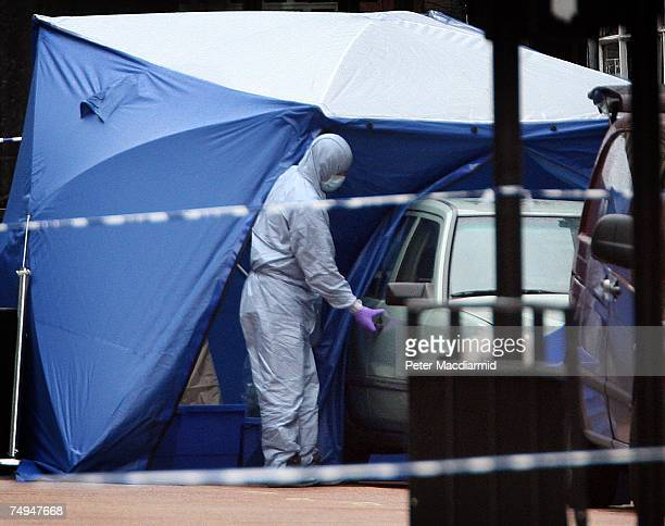 A police forensics officer examines a car suspected of carrying a bomb in Haymarket on June 29 2007 in London England The police were notified...