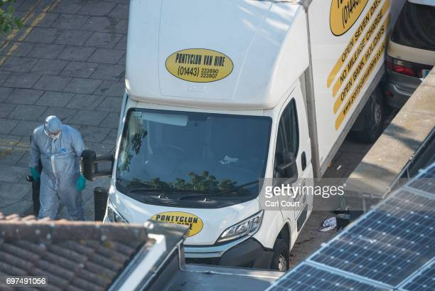 A police forensics officer examines a van believed to be involved in an incident near Finsbury Park Mosque in which one man was killed after a...