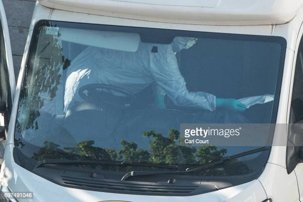 A police forensics officer examines the interior of a van believed to be involved in an incident near Finsbury Park Mosque in which one man was...