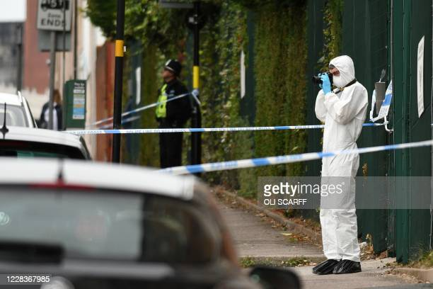 Police forensics officer gathers evidence inside a cordon on Irving Street, following a major stabbing incident in the centre of Birmingham, central...