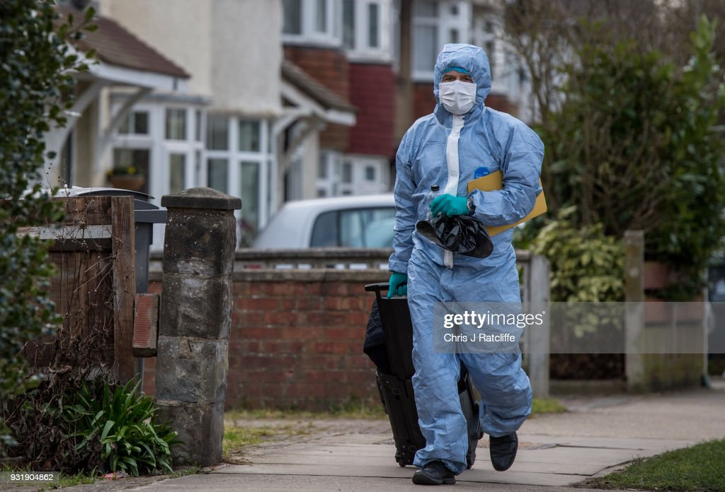 A police forensics officer walks down the road before entering a police tent outside the home of Russian exile Nikolai Glushkov who was found dead at his home in New Molden on March 14, 2018 in London, England. Metropolitan police have said the counter-terrorism command unit was leading the investigation into the man's death, the cause of which is not yet clear.
