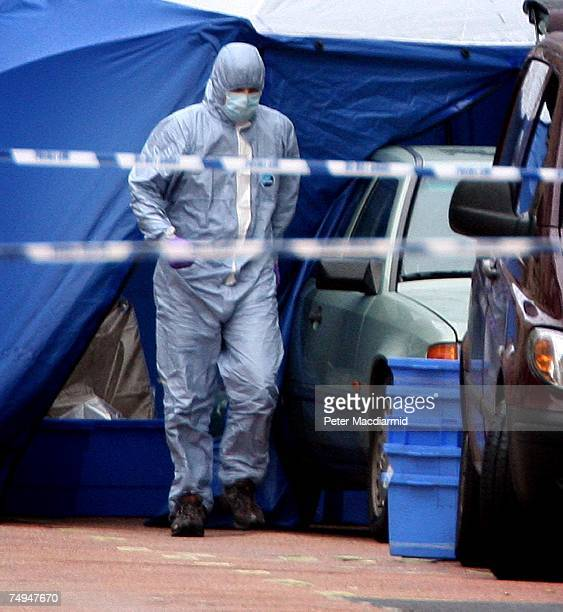 A police forensics officer walks past a car suspected of carrying a bomb in Haymarket on June 29 2007 in London England The police were notified...