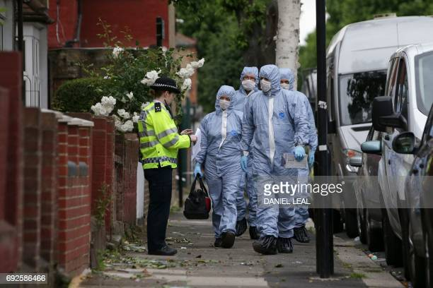TOPSHOT Police forensics officers continue to work at a residential property in east London on June 5 following a raid as part of their...