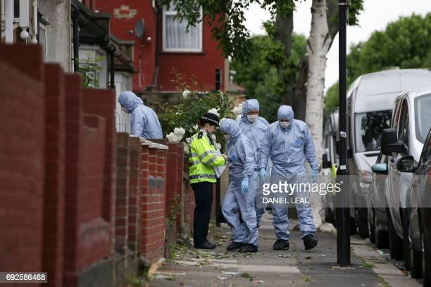 Police forensics officers continue to work at a residential property in east London on June 5 following a raid as part of their investigations...