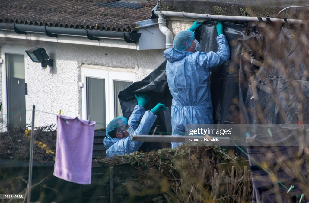 Police forensics officers erect a tarpaulin sheet over the rear of the home of Russian exile Nikolai Glushkov who was found dead at his home in New Molden on March 14, 2018 in London, England. Metropolitan police have said the counter-terrorism command unit was leading the investigation into the man's death, the cause of which is not yet clear.