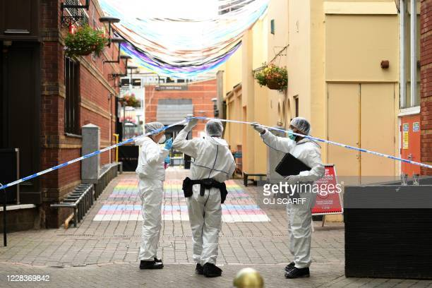 Police forensics officers gather evidence inside a cordon on Hurst Street, following a major stabbing incident in the centre of Birmingham, central...
