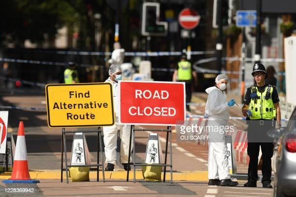 TOPSHOT Police forensics officers gather evidence inside a cordon on Hurst Street following a major stabbing incident in the centre of Birmingham...