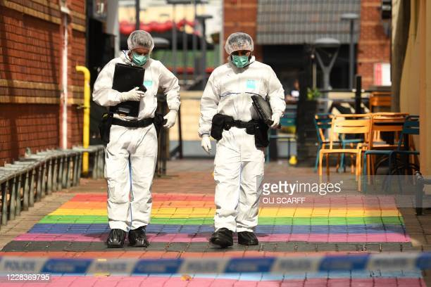 Police forensics officers gather evidence on Hurst Walk, inside a cordon at Hurst Street, following a major stabbing incident in the centre of...