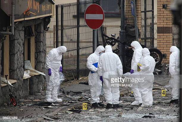 Police forensics officers inspect the scene of an exploded car bomb that detonated outside Newtownhamilton Police station in South Armagh Northern...