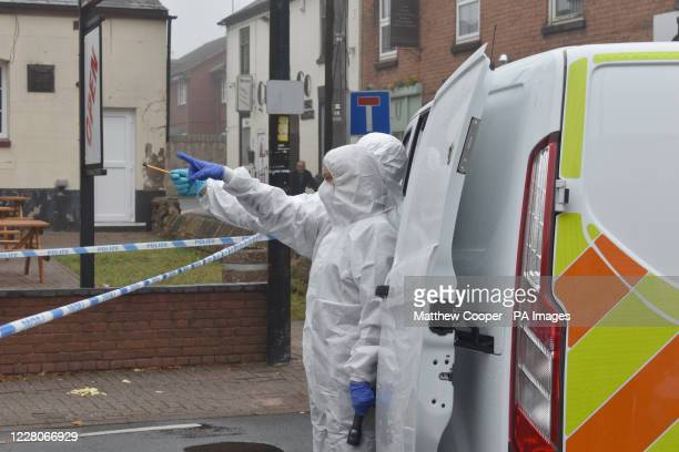 Police forensics officers near The Clifton pub in Sedgley, West Midlands, after the death of a 24-year-old following a pub fight.