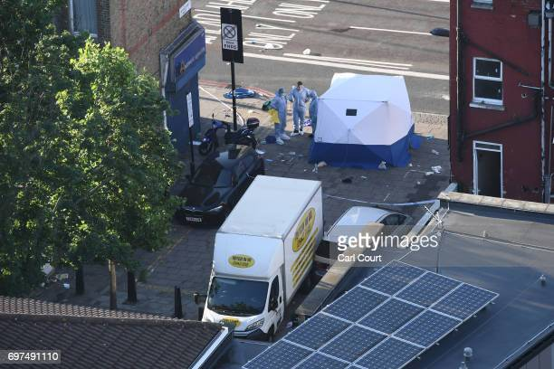 Police forensics officers prepare to examine the scene near Finsbury Park Mosque in which one man was killed after a vehicle ploughed into...