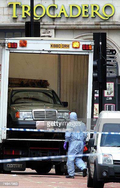 Police forensics officers remove a car suspected of carrying a bomb in Haymarket on June 29 2007 in London England The police were notified shortly...