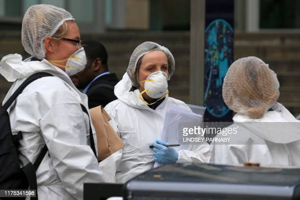 Police forensics officers work outside Arndale Centre shopping complex in Manchester northwest England on October 11 following a series of stabbings...