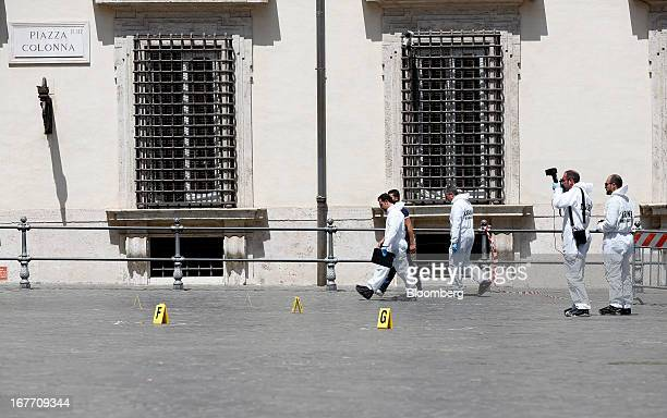 Police forensics officers work outside the Chigi Palace following a shooting in Rome Italy on Sunday April 28 2013 Two Italian police officers were...