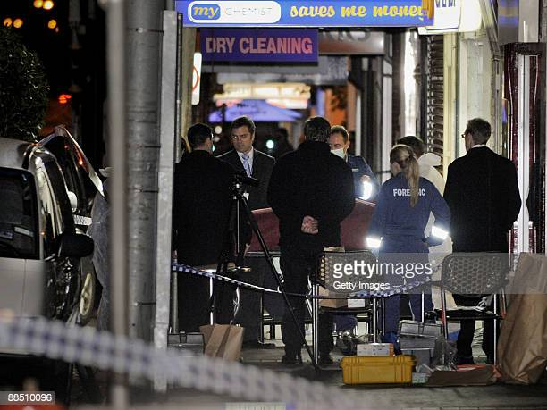 Police forensics remove the body of underworld figure Desmond 'Tuppence' Moran who was shot dead earlier today, at a deli at Ascot Vale on June 15,...