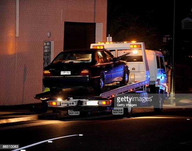 Police forensics remove the car of underworld figure Desmond 'Tuppence' Moran who was shot dead earlier today at a deli at Ascot Vale on June 15 2009...