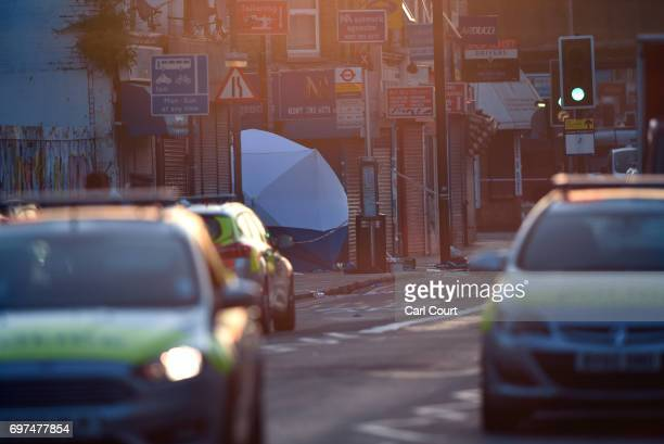 A police forensics tent is erected by the scene of an incident in which a van hit worshippers near Finsbury Park Mosque on June 19 2017 in London...