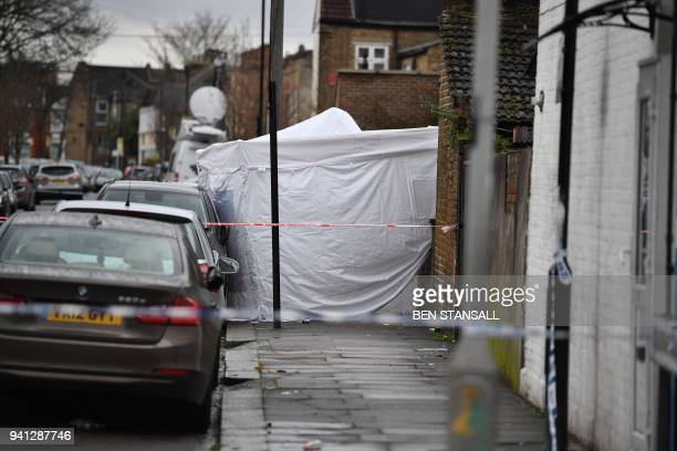 A police forensics tent is seen behind a police cordon at the scene of a fatal shooting in north London on April 3 2018 A 17 yearold girl died after...
