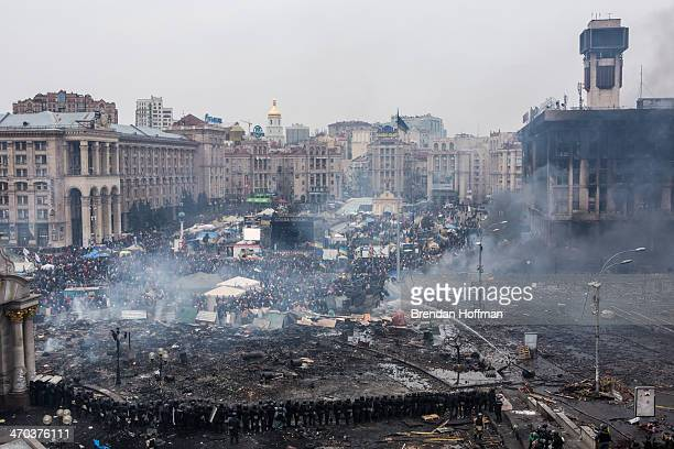 Police form a barrier in Independence Square on February 19 2014 in Kiev Ukraine After several weeks of calm violence has again flared between...