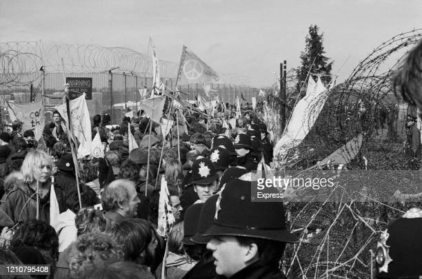 Police form a cordon during a Campaign for Nuclear Disarmament demonstration at the Royal Airforce base near Molesworth Cambridgeshire England 9th...