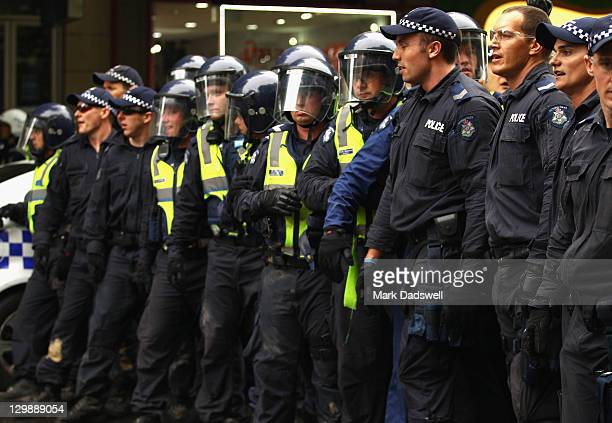 Police form a line across Elizabeth Street as 'Occupy Melbourne' protestors confront them on October 21 2011 in Melbourne Australia Protesters and...