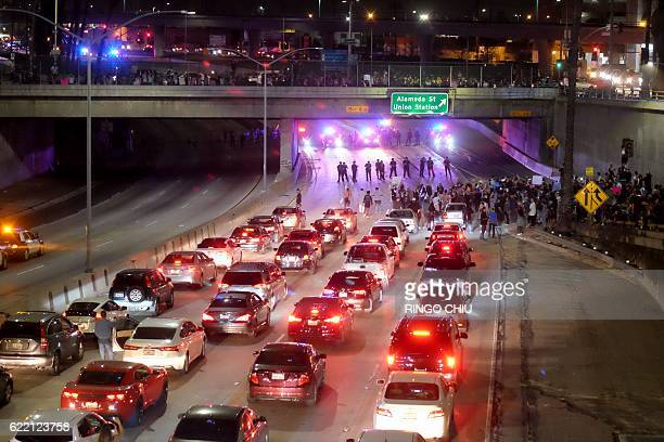 Police form a line across the road as demonstrators shut down the 101 Freeway a major thoroughfare in the city following a rally to protest a day...