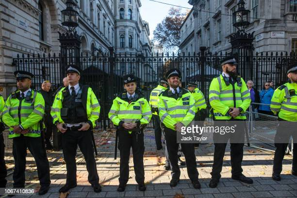 Police form a line as climate activists demonstrate outside Downing Street on November 14 2018 in London England Climate activist group Extinction...