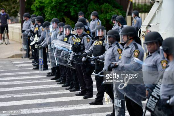 Police form a line to disallow access for a protest march through Center City on June 1 2020 in Philadelphia Pennsylvania Demonstrations have erupted...