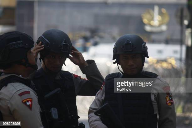 Police from the Mobile Brigade Corps were on guard in front of the Mobile Brigade Corps Command Headquarters in Depok West Java on Thursday May 9 in...