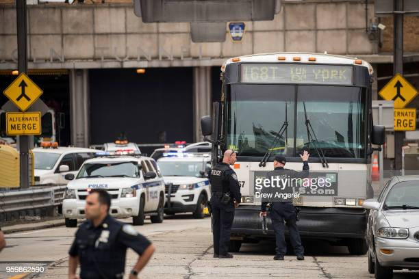 Police from the Port Authority of New York and New Jersey investigate a New Jersey Transit bus that was involved in a morning crash near the...