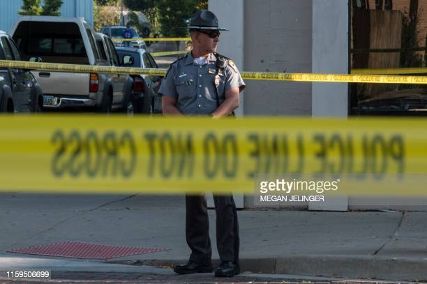 Police gather after an active shooter opened fire in the Oregon district in Dayton Ohio on August 4 2019 Nine people were killed in a mass shooting...