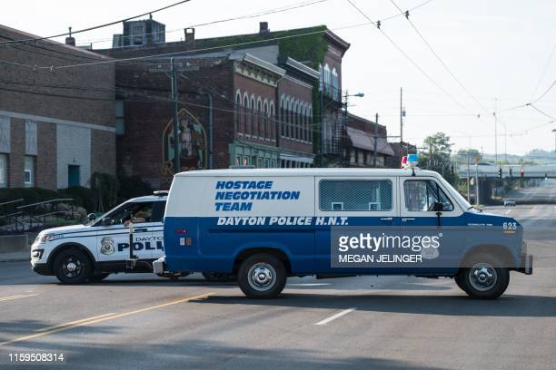 Police gather after an active shooter opened fire in the Oregon district in Dayton, Ohio on August 4, 2019. - Nine people were killed in a mass...