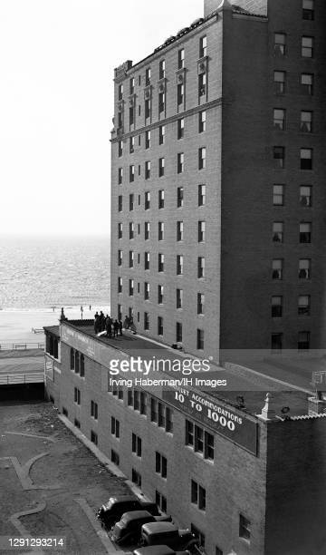 """Police gather around the body of Abe """"Kid Twist"""" Reles on the rooftop of the Half Moon Hotel on November 12, 1941 in Brooklyn, New York. This was the..."""