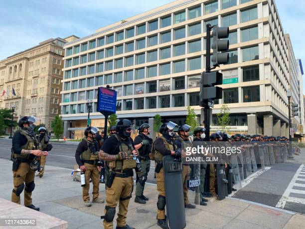 Police gather as the first line to keep demonstrators away from Lafayette Square near the White House on June 3 2020 in WashingtonDC amongst the...