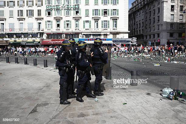 Police gather as they clash with England fans ahead of the game against Russia later today on June 11 2016 in Marseille France Football fans from...