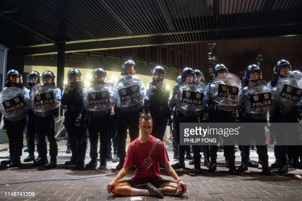TOPSHOT Police gather at a rally against a controversial extradition law proposal in Hong Kong on early June 10 2019 Hong Kong witnessed its largest...