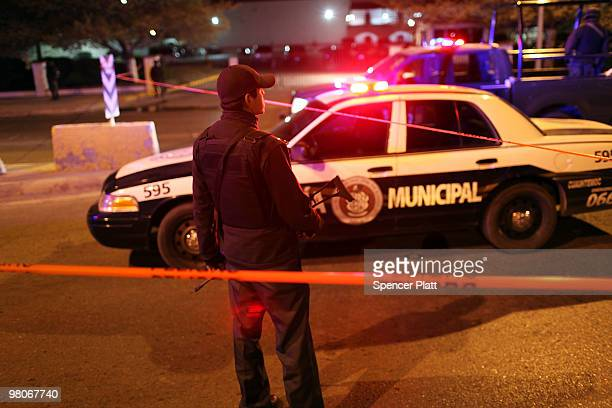 Police gather at an early morning murder one of numerous murders over a 24 hour period on March 26 2010 in Juarez Mexico Secretary of State Hillary...