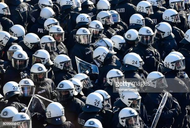 Police gather at Hamburg harbor prior to the âWelcome to Hell❠antiG20 protest march on July 6 2017 in Hamburg Germany Leaders of the G20 group of...