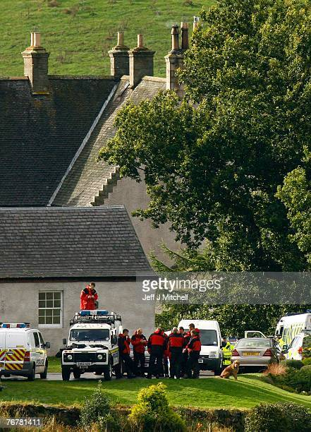Police gather at the home of Colin McCrae near Lanark where a twin squirrel helicopter crashed September 16 2007 in Lanark Scotland The former world...