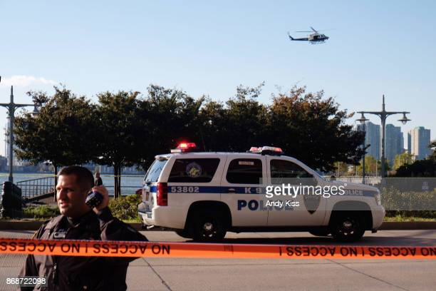 Police gather at the scene after reports of multiple people injured after a truck plowed through a bike path in lower Manhattan on October 31 2017 in...
