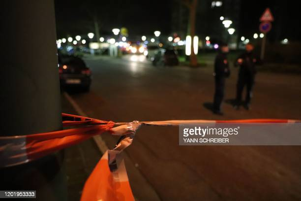 Police gather at the scene of a shooting in Hanau western Germany on February 20 2020 At least eight people were killed in two shootings late on...