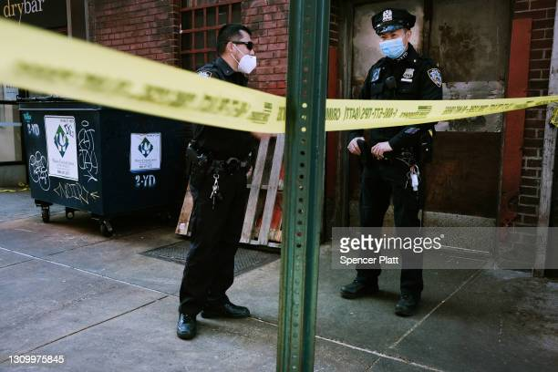 Police gather at the scene of an afternoon shooting along Ludlow Street in a trendy section of lower Manhattan on March 30, 2021 in New York City. A...