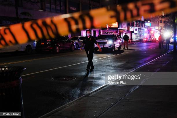 Police gather at the scene where two New York City police officers were shot in a confrontation late Wednesday evening in Brooklyn on June 03, 2020...